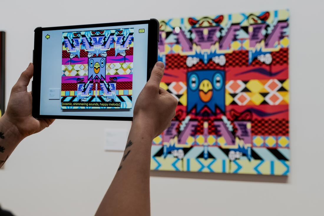 Photo of Augmented reality on iPad looking at artwork at the Josh Muir Exhibition at Bendigo Art Gallery
