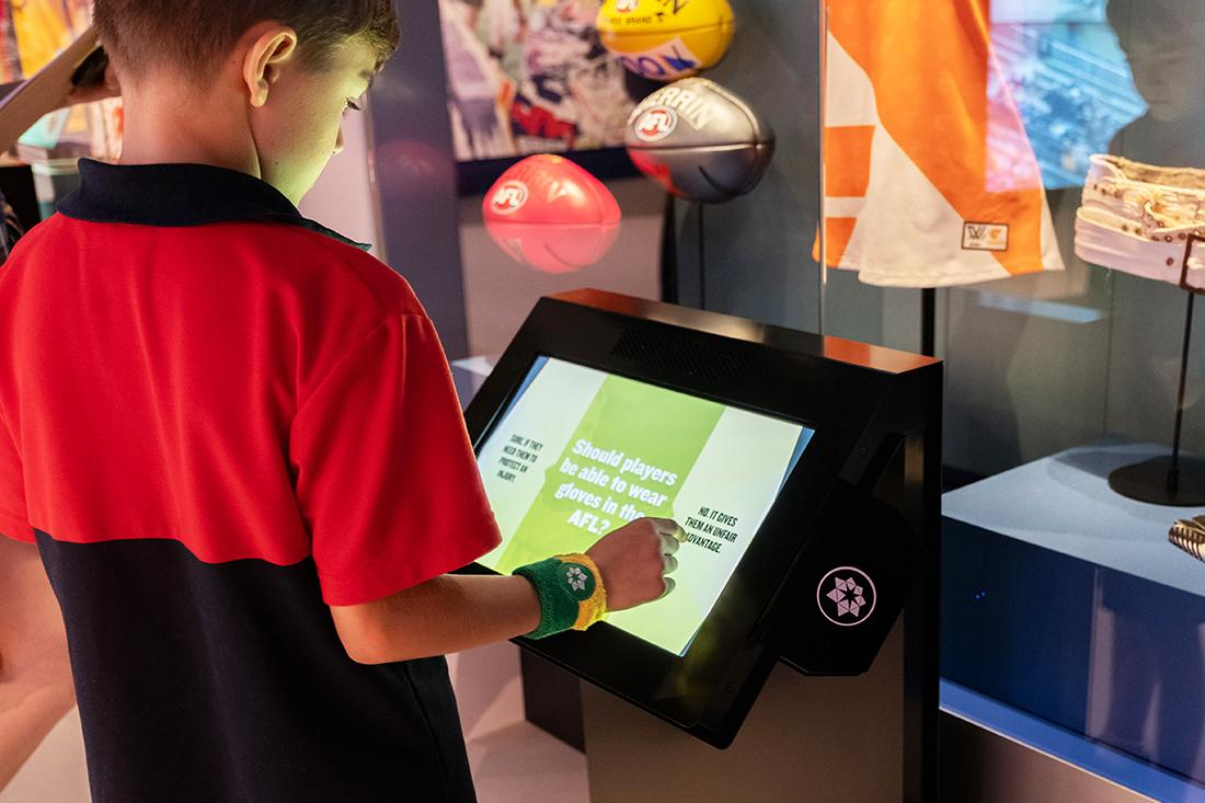 Student using interactive touch panel at Australian Sports Museum Melbourne